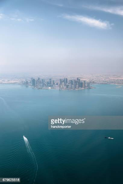 aerial view of doha in qatar - qatar desert stock photos and pictures