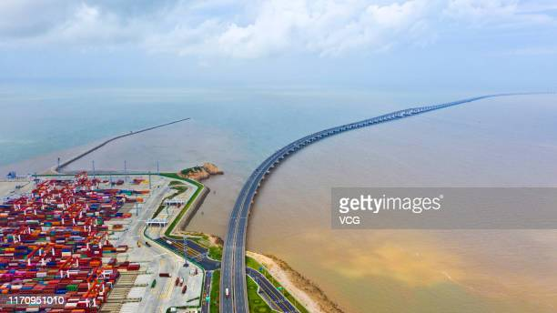 Aerial view of Donghai Bridge which connects Shanghai's Pudong New Area and Yangshan Deepwater Port operated by Shanghai International Port Co Ltd on...