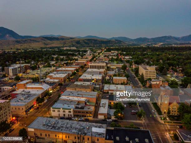 aerial view of downtown bozeman at twilight - bozeman stock pictures, royalty-free photos & images