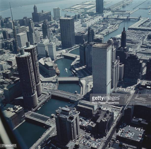 Aerial view of downtown Chicago with the Chicago River winding between various skyscraper office buildings through the Chicago Loop area to Lake...