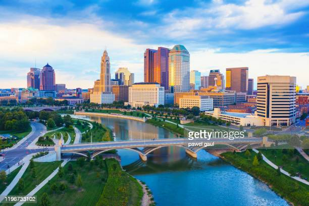 aerial view of downtown columbus ohio with scioto river - ohio stock pictures, royalty-free photos & images