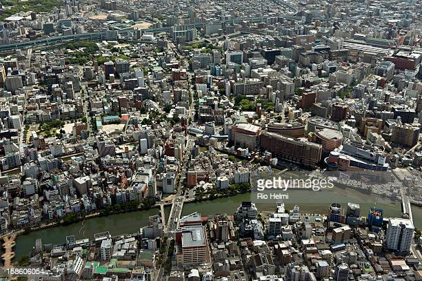 Aerial view of downtown Fukuoka City with Canal City in Hakata the largest mall in town visible on the right with Naka river in the foreground