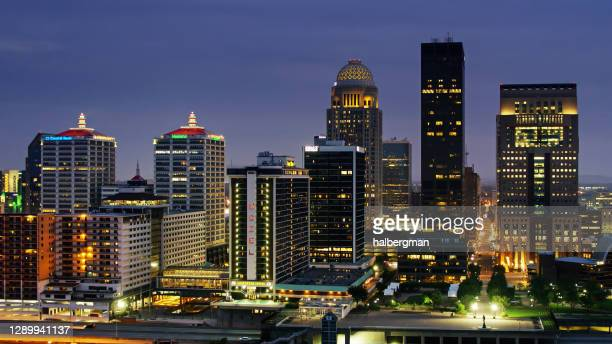 aerial view of downtown louisville skyline at night - louisville kentucky stock pictures, royalty-free photos & images