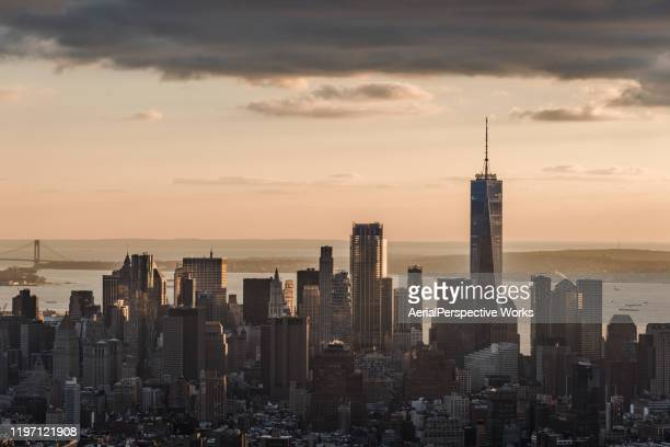 aerial view of downtown manhattan at sunset / nyc - international landmark stock pictures, royalty-free photos & images