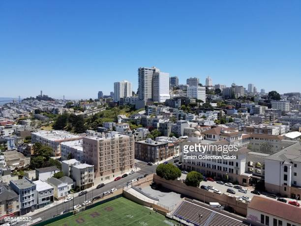 Aerial view of downtown San Francisco California on a sunny day with Coit Tower the San Francisco Bay Bridge Nob Hill and Pacific Heights visible...