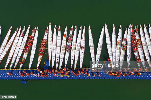 Aerial view of dragon boat teams preparing for the dragon boat race on the Fujiang River on May 4 2017 in Suining Sichuan Province of China 34 dragon...
