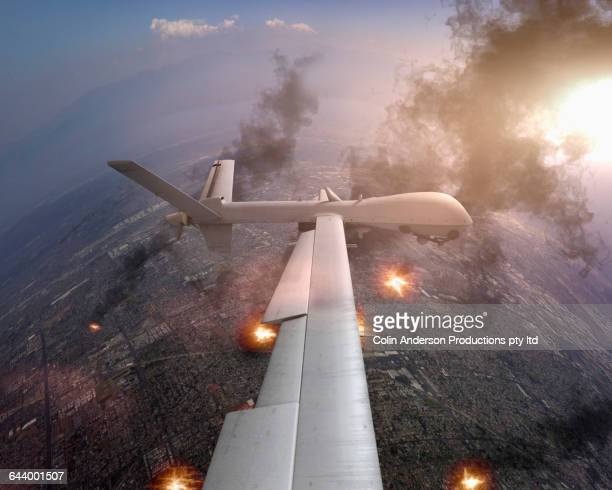 aerial view of drone flying over war torn landscape - military drones stock photos and pictures