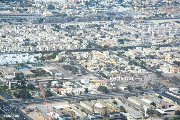 aerial view of dubai city - housing development stock pictures, royalty-free photos & images