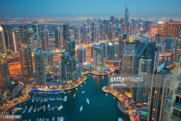 aerial view of dubai marina at dusk - dubai stock pictures, royalty-free photos & images