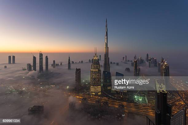 A aerial view of Dubai Skylines at Sunrise during a foggy Morning on December 28 2016 in Dubai United Arab Emirates