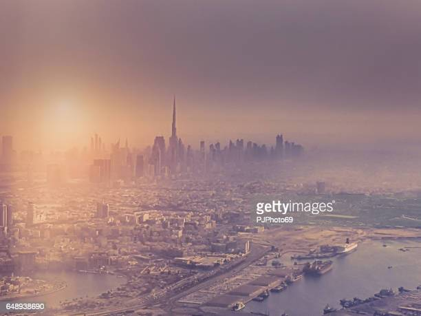 Aerial view of Dubai with some fog at sunset
