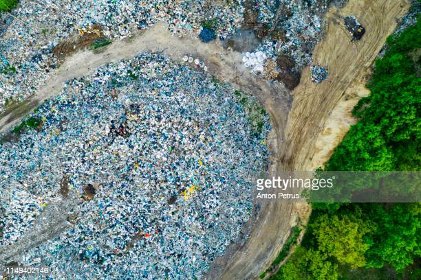 aerial view of dump in forest. pollution concept, top view. - landfill stock photos and pictures