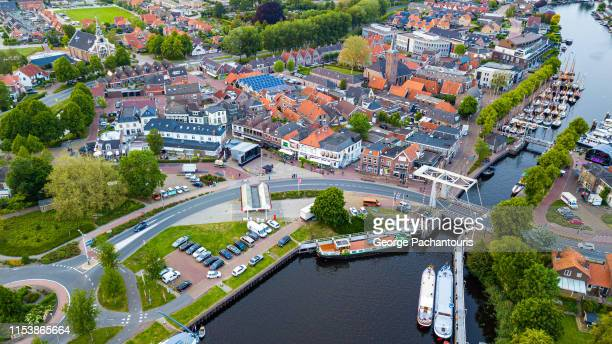 aerial view of dutch town with canal and boats - overijssel stock pictures, royalty-free photos & images