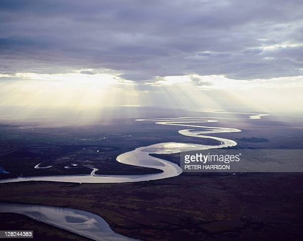 aerial view of east alligator river w/sunlight under clouds, kakadu, nt