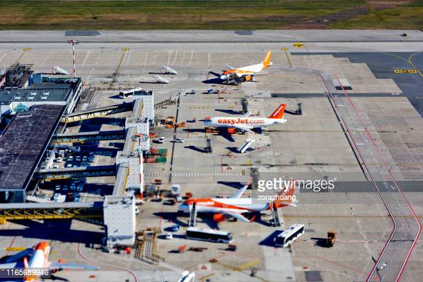 aerial view of eastjet's airplane at malpensa international airport, milan, italy - easyjet stock pictures, royalty-free photos & images