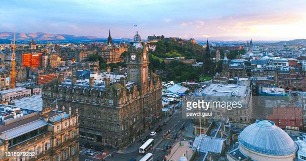 aerial view of edinburgh city during sunset scotland - edinburgh scotland stock pictures, royalty-free photos & images