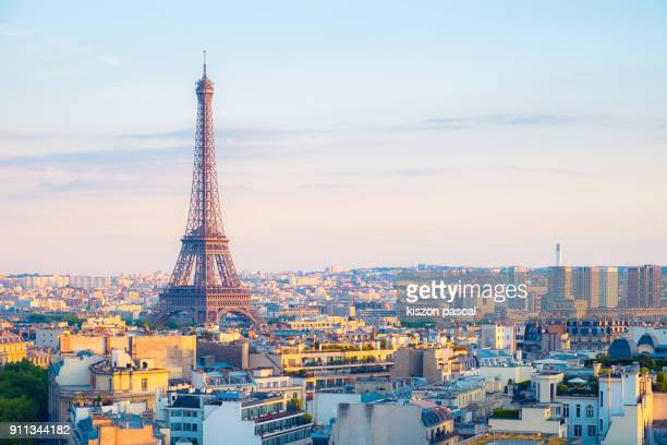 aerial view of eiffel tower and paris during a sunny day . . - eiffel tower stock photos and pictures