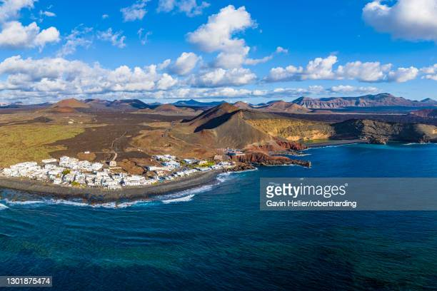 aerial view of el golfo village and the volcanic landscape of timanfaya national park, lanzarote, canary islands, spain, atlantic, europe - gavin hellier stock pictures, royalty-free photos & images