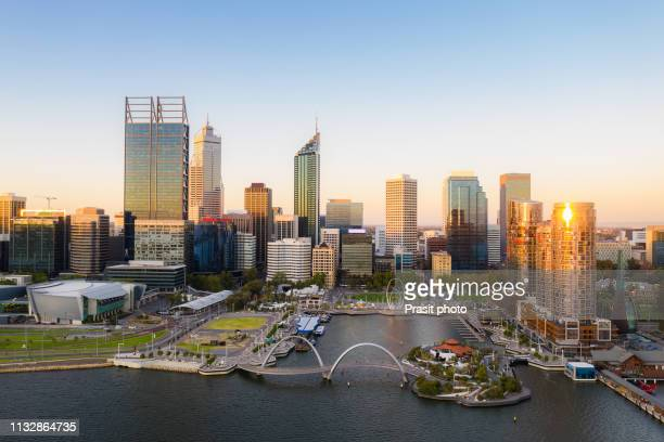 aerial view of elizabeth quay waterfront during sunset in perth, western australia state, australia. - perth stock pictures, royalty-free photos & images