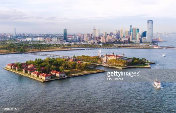 aerial view of ellis island and jersey city - ellis island stock photos and pictures