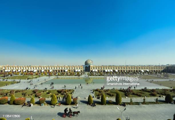 aerial view of 'emam square' ('naqsh-e jahan square') with sheikh lotfollah mosque ('masjed-e sheikh lotfollah') on the background in isfahan, iran - isfahan stock pictures, royalty-free photos & images