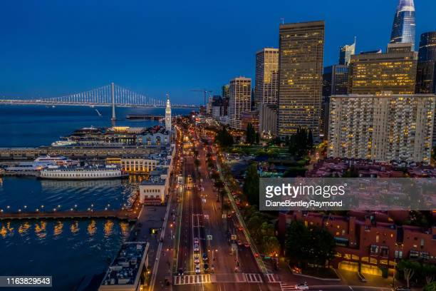 aerial view of embarcadero at blue hour - oakland bay bridge stock pictures, royalty-free photos & images