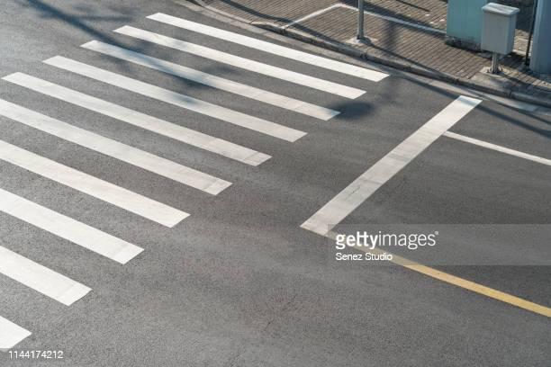 aerial view of empty asphalt road - strisce pedonali foto e immagini stock