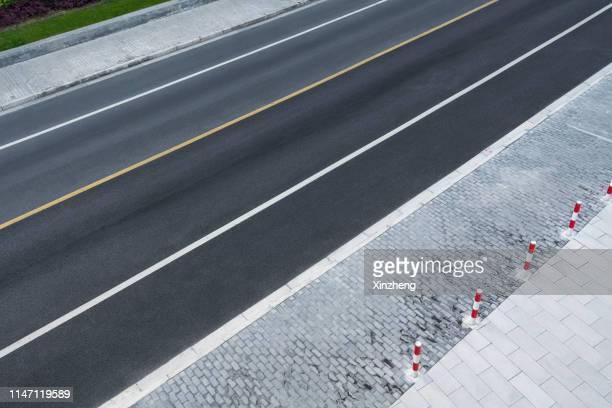 aerial view of empty asphalt road - 境界線 ストックフォトと画像