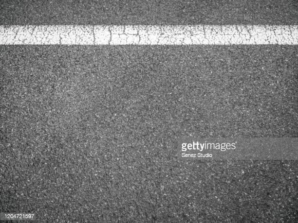 aerial view of empty asphalt road - asfalt stockfoto's en -beelden