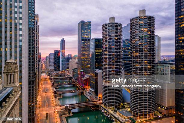 aerial view of empty chicago riverwalk during covid-19 pandemic - chicago river stock pictures, royalty-free photos & images
