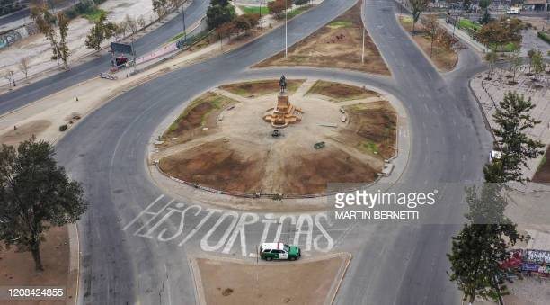 Aerial view of empty Italia square in Santiago, Chile, on March 27, 2020. - More than 1.3 million people of seven of the main communes of Santiago...
