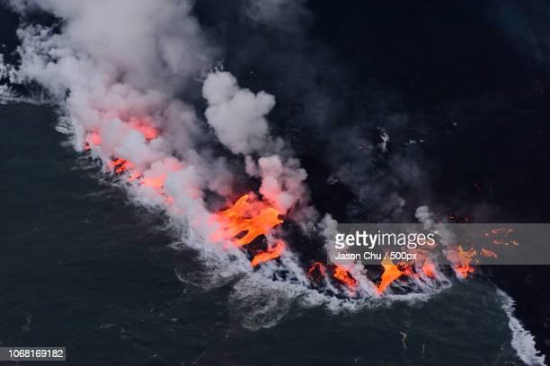 aerial view of erupting volcano - 噴出 ストックフォトと画像