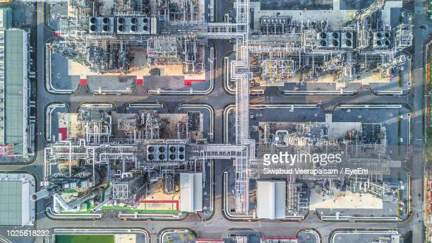 aerial view of factory in city - manufacturing equipment stock pictures, royalty-free photos & images