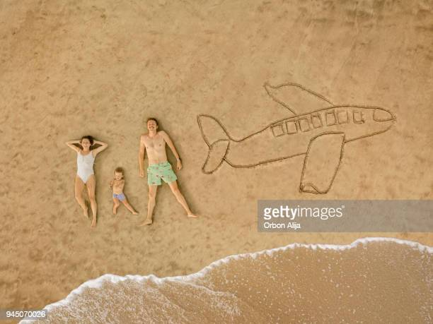 aerial view of family at the beach - beach holiday stock pictures, royalty-free photos & images