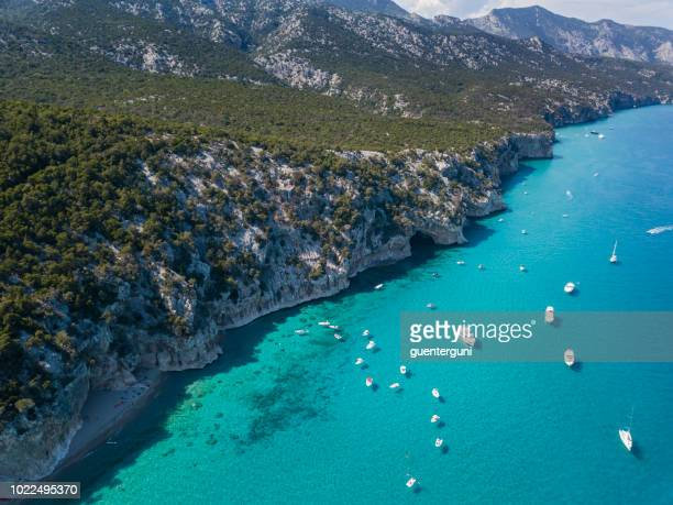 aerial view of famous cala luna beach, sardinia - costa smeralda stock pictures, royalty-free photos & images