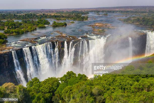 aerial view of famous victoria falls, zimbabwe and zambia - zimbabwe stock pictures, royalty-free photos & images