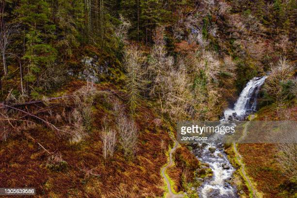 aerial view of fast flowing river and waterfall - johnfscott stock pictures, royalty-free photos & images