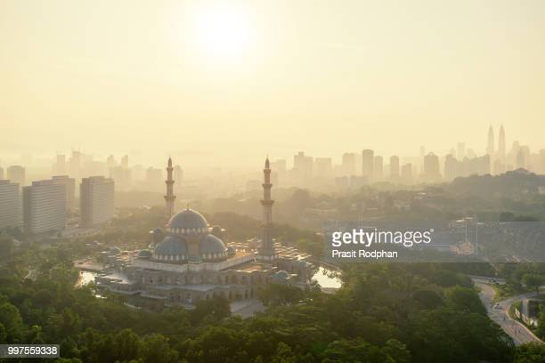 Aerial view of Federal Territory Mosque during sunset.