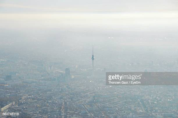 Aerial View Of Fernsehturm Amidst Buildings In Foggy Weather