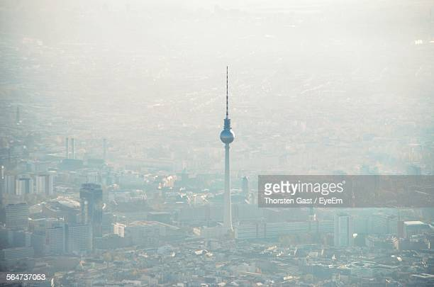 aerial view of fernsehturm amidst city during foggy weather - television tower berlin stock pictures, royalty-free photos & images