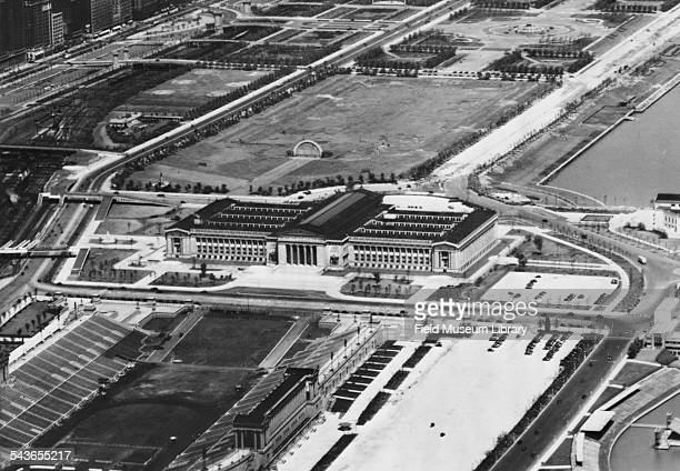 Aerial view of Field Museum building looking north with a portion of Solider Field train tracks and the Grant Park bandshell visible Chicago Illinois...