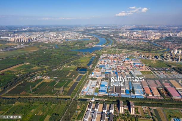 aerial view of fields landscape and city - liyao xie ストックフォトと画像