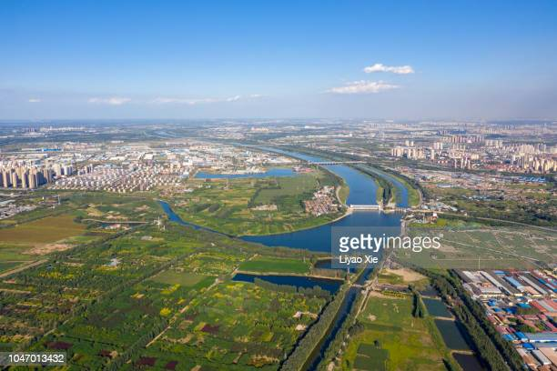 aerial view of fields landscape and city - liyao xie stock pictures, royalty-free photos & images