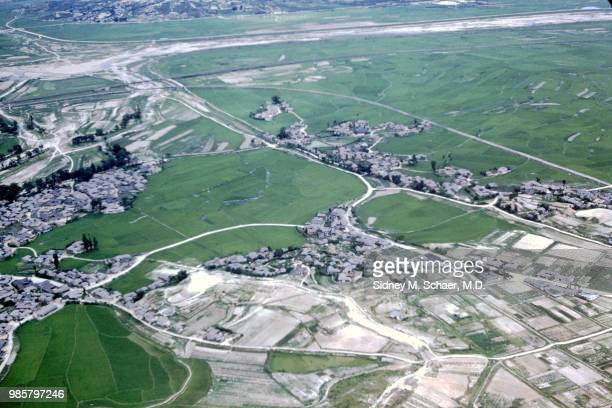 Aerial view of fields villages and roads on the outskirts of Seoul South Korea July 1952