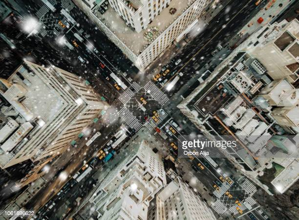 aerial view of fifth avenue snowing - midtown manhattan stock pictures, royalty-free photos & images