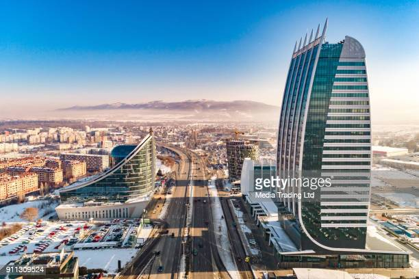 aerial view of financial business district luxury skyscraper tower surrounded by smog air pollution - bulgaria stock pictures, royalty-free photos & images