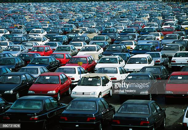 Aerial view of finished Peugeot 405 and 605 cars in an outdoor parking lot at the Peugeot PSA factory in Sochaux