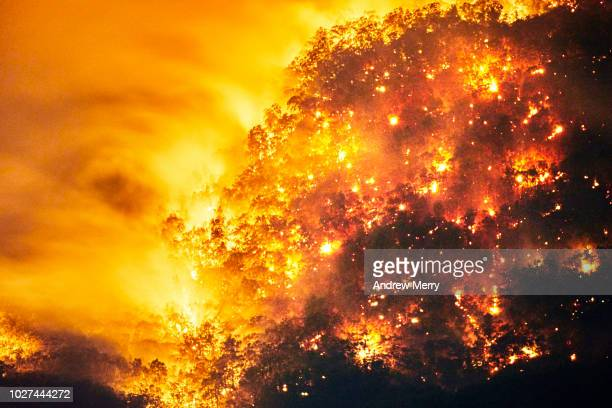 aerial view of fire, forest fire, bushfire in valley, blue mountains, australia - hell stock pictures, royalty-free photos & images