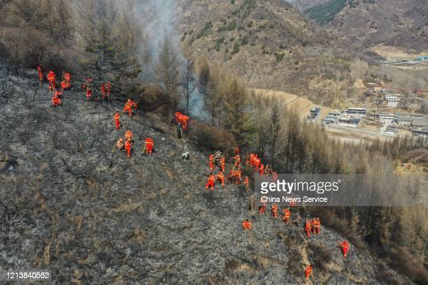 Aerial view of firefighters working at a fire site on the Wutai Mountain on March 21 2020 in Xinzhou Shanxi Province of China The fire which occurred...
