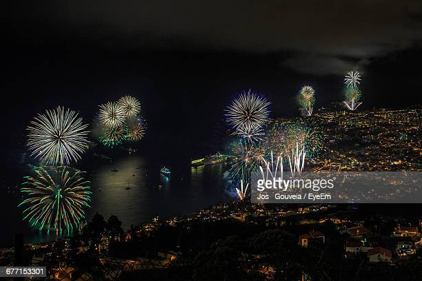 Aerial View Of Firework Display Over Sea And Illuminated Madeira Island At Nigh